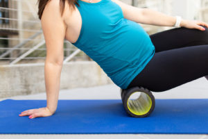 female with foam roller